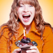 Happy birthday girl with party cupcake — Stock Photo