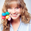 Fun party girl with balloons in mouth - Stock Photo