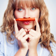 Thinking student with orange crayon moustache - Stok fotoğraf