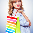 Royalty-Free Stock Photo: Happy shopaholic returning with her purchases