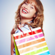 Stock Photo: Smiling Woman With Shopping Bag