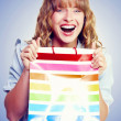 Bargain shopping woman laughing with joy — Stock Photo