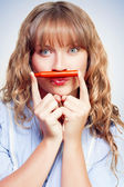 Thinking student with orange crayon moustache — Stock Photo