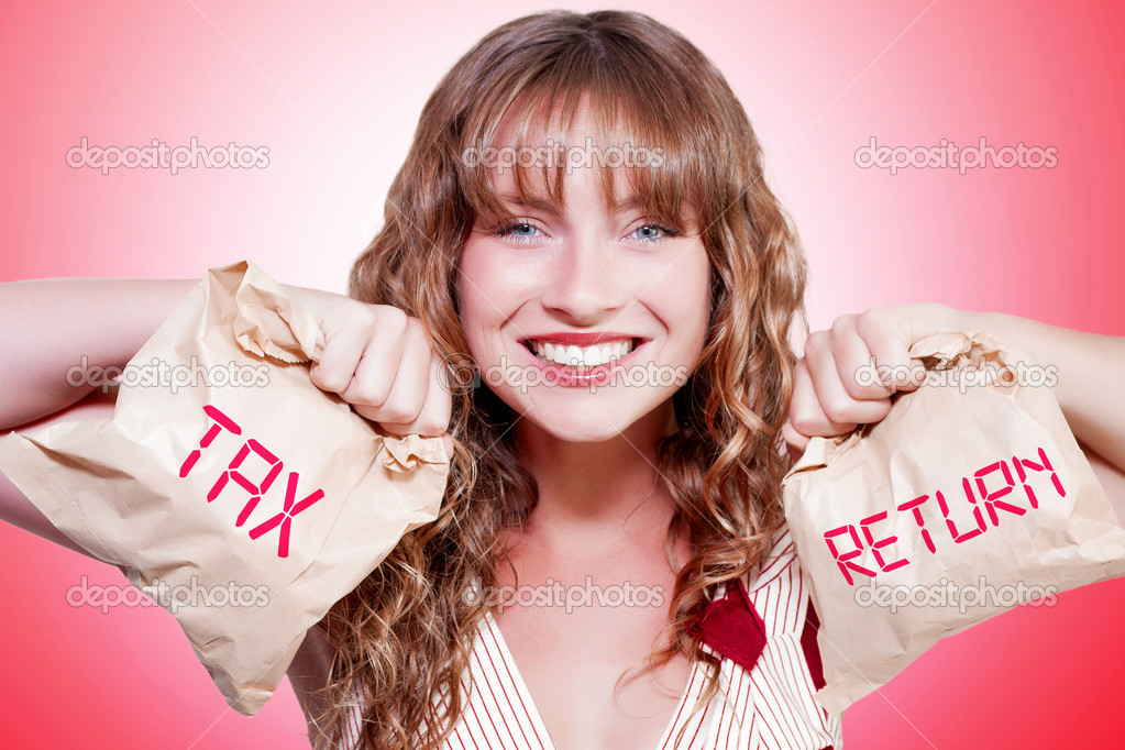 Studio Photo Of A Happy Woman Smiling With Brown Paper Bags Stuffed With Money In A Accounting Income Tax Return Concept  Stock Photo #12160109
