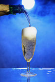 Champagne party with smoke mysterious background — Stock Photo