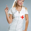 Very sexy woman in kinky nurse outfit — Stock Photo