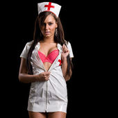 Very sexy woman in kinky nurse uniform — Stock Photo