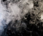 Grey smoke with black background — Stock Photo