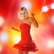 Beautiful girl is dancing in smoke and lights — Stock Photo