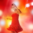 Beautiful girl is dancing in smoke and lights — Stockfoto