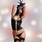 Kinky woman with venetian mask and lingerie — Stock Photo