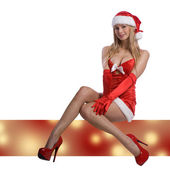 Very sexy christmas woman with red santa look on white backgroun — Zdjęcie stockowe