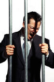 Very good looking office manager is screaming behind prison bars — Stock Photo