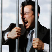 Very good looking office manager is screaming behind prison bars — Stok fotoğraf