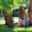 Girl under a palm tree — Stock Photo #11113727