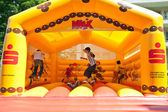Kids jumping on an inflatable trampoline. — Stock Photo