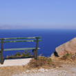 Stock Photo: Bench overlooking sea