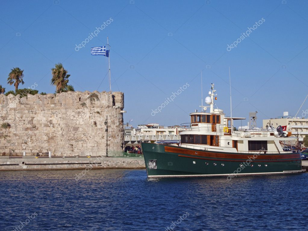 Boat leaving from Kos town harbour - Kos Island - Greece  Stock Photo #10859328