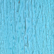 Broken paint on blue wall — Stock Photo