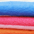 Colour terry towels combined by pile on white background. Isolated. — Stock Photo