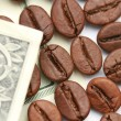 Stock Photo: Coffee against dollar