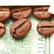 Coffee against dollar — Stock Photo