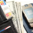 Wallet sticking in denominations of 100 Dolar — Stock Photo