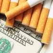 Filters of cigarettes close up cigarettes and Dolar — Stock Photo