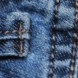 Highly detailed jeans texture with vertical seam. Cbe used as background. — Stock Photo #10970935