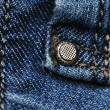 Highly detailed jeans texture with vertical seam. Can be used as a background. - Stock Photo