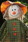 Scarecrow in the garden — Stock Photo