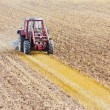 Stock Photo: Tractor with cultivator