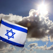 Israeli flag against cloudy sky - Stock Photo