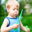 Boy inflates bubbles in the nature — Stock Photo