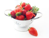 Strawberries in a white drushlake isolated background — Stock Photo