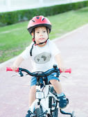 A boy on a bicycle on a background of nature — Stock Photo