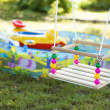 Children's swing - Stock Photo