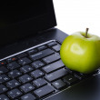 Apple on laptop keyboard — Stock Photo