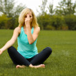 Young girl doing yoga outdoor — Stock Photo