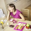 beauitful female model yawning very much during breakfast — Stock Photo