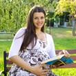Beautiful pregnant womreading book — Stock Photo #12274611