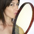 Tennis player kissing her racket — Stock Photo