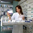 Pharmacist woman looking for medicine - Stock Photo