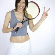 Woman tennis player victory sign — Stock Photo #12401054