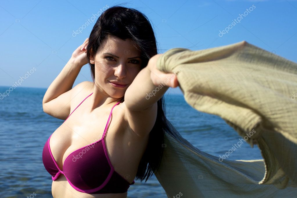 Happy gorgeous female model in the blue sea playing with veil  Stock Photo #12402252