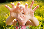 Little girl plays the fool — Stock Photo
