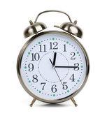 Alarm clock in a metal case — Stock Photo