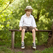 Stock Photo: Fair-haired boy in hat, shirt, shorts