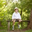 Little boy in a hat, shorts — Stock Photo
