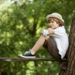 Stock Photo: Boy sits on bench